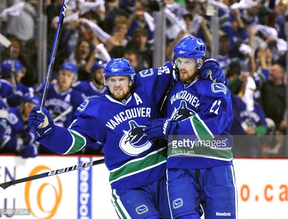 The Sedin twins powered the '09-'10 Canucks by the '92-'93 Canucks for their first UNP appearance. (via Rich Lam/Getty Images)