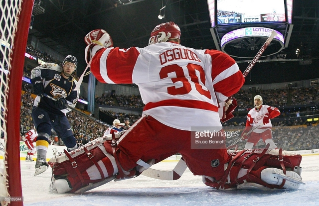 Goaltender _____ Osgood finished off a good series with a 30-save shutout to send the '07-'08 Red Wings to another UNP. (via Bruce Bennett/Getty Images)